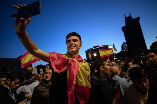 Vox supporters attend an election campaign event in Madrid.