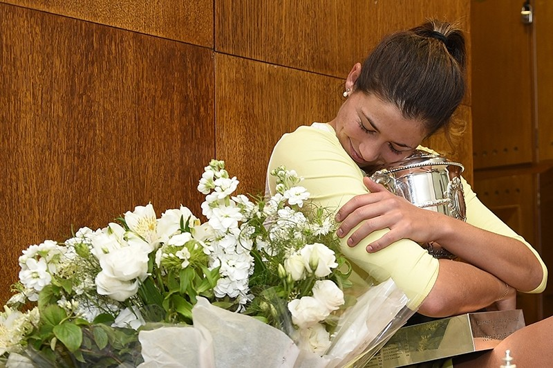 Spain's Garbine Muguruza holds her cup in the dressing room after defeating Serena Williams of the U.S. in the women's final of the French Open. (AP Photo)