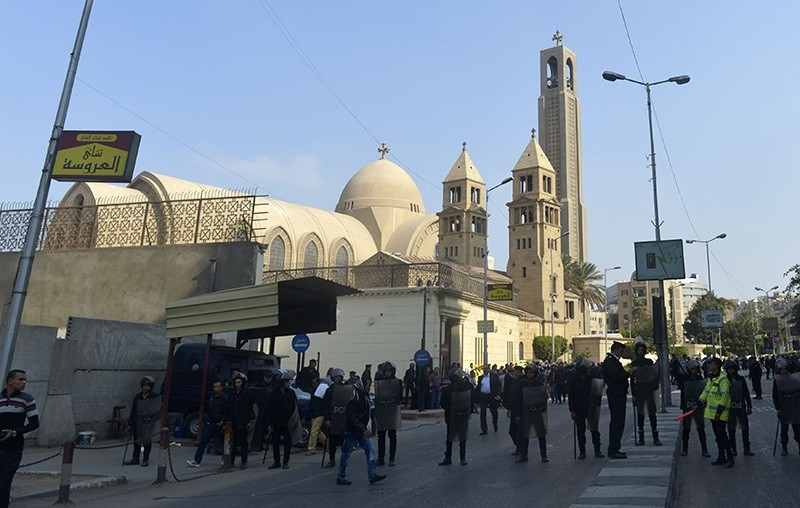 Egyptian security forces gather at the site of an explosion at the Saint Mark's Coptic Orthodox Cathedral on December 11, 2016 in the Abbasiya neighbourhood in the capital Cairo (AFP Photo)
