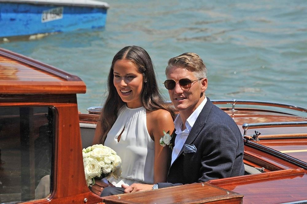 Serbian tennis player Ana Ivanovic and German soccer player Bastian Schweinsteiger sit on a boat after their wedding in Venice, Italy, 12 July 2016. (EPA Photo)