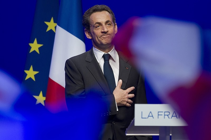 This Sunday May 6, 2012 file photo shows outgoing French President Nicolas Sarkozy acknowledging applause of his supporters at his Union for a Popular Movement (UMP) party headquarters. (AP Photo)