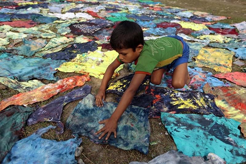 In this Dec. 22, 2012 file photo, a Bangladeshi child works at a clothes-dyeing factory in Narayanganj, outskirts of Dhaka, Bangladesh (AP Photo)