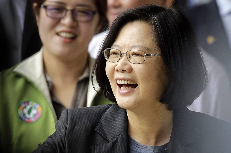 Taiwan President Tsai Ing-wen smiles at supporters as she arrives to vote for party officials in Taipei, Taiwan, 22 May 2016 (EPA Photo)