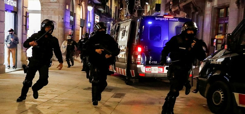 PROTESTERS CLASH WITH POLICE OVER COVID-19 RESTRICTIONS IN BARCELONA