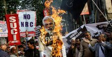 Indian farmers threaten to burn Trump, Modi effigy