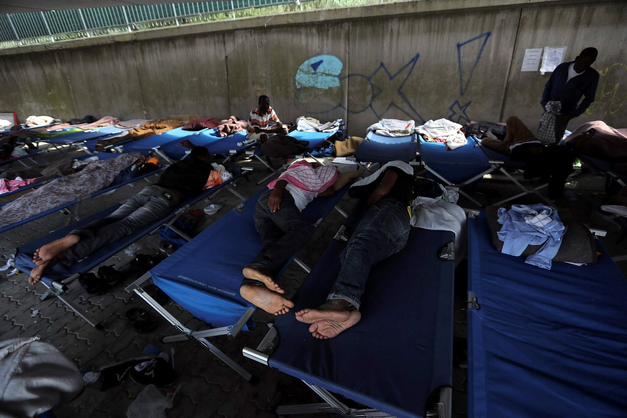 Migrants sleep on camp beds at a Red Cross center in the city of Ventimiglia on the French-Italian border on Sept. 14.