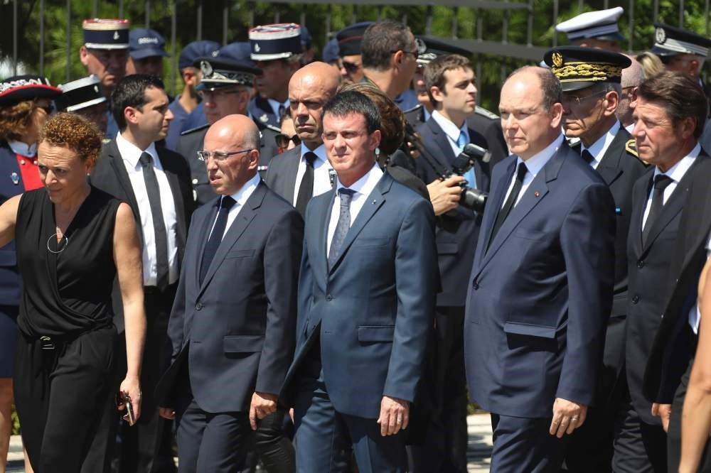 French Prime Minister Manuel Valls (C) arrives to attend a minute silence in Nice in tribute to the victims of the deadly attack on Bastille day.