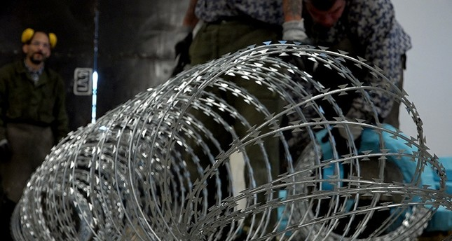 Prison inmates are manufacturing razor wire used on the fences Hungary has built on its borders with Serbia and Croatia to stop the flow of migrants and refugees, in Marianosztra, Hungary, Wednesday, Sept. 21, 2016. (AP Photo)
