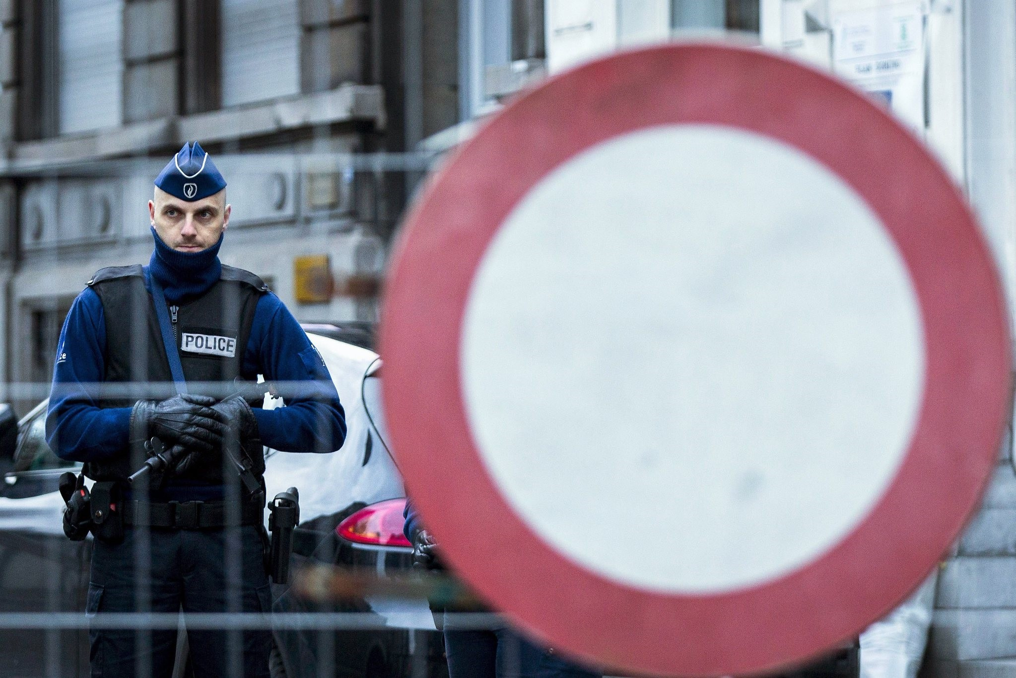 A policeman stands guard at Colline street in Verviers, eastern Belgium during last year's anti-terror operations (AFP Photo)