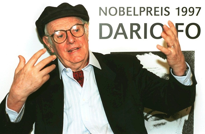 This Oct. 16, 1997 file photo shows Italy's winner of the 1997 Nobel Prize of Literature Dario Fo as he gives an interview during his visit to his German publishing house ,Rotbuch Verlag, at the 49th Frankfurt Book Fair, Germany. (AP Photo)