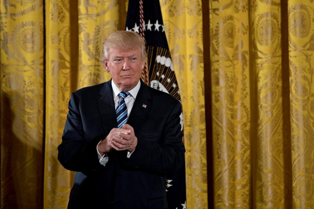 U.S. President Donald Trump listens during a swearing in ceremony of White House senior staff in the East Room of the White House in Washington, DC, U.S., on Jan. 22.