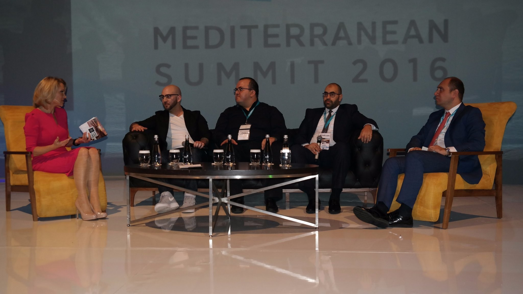 K. Madera (L) of BBC World News moderates the u201cMulti-Channel Usage of Tourismu201d session in which W. Isbrucker (Booking), E. u00c7elik (Head of Sales Facebook), B. Badr (Attar Travel), & A. u0130u015fbulan (Gen. Manager TAV Op. Serv.) speak (from left to right).