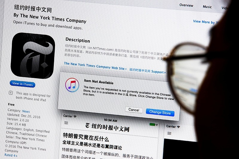 An illustration shows a person looking at a computer screen in Beijing showing anu00a0Appleu00a0iTunes store message saying that theu00a0Newu00a0Yorku00a0Timesu00a0app is not available in the Chinese store, China, Jan. 5, 2017. (Reuters Photo)