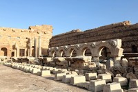 Ali Hribish stands by the Arch of Septimius Severus, which dominates Libya's ancient city of Leptis Magna, brandishing letters of thanks for his efforts to protect the site.  The former...