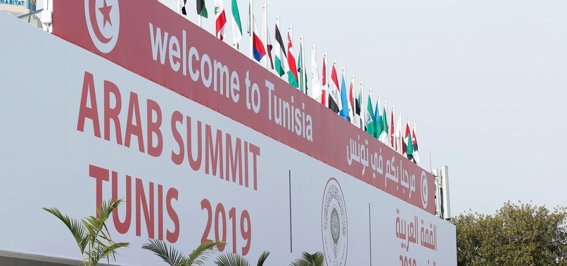 HALF OF ARAB LEADERS ABSENT FROM TUNISIA SUMMIT