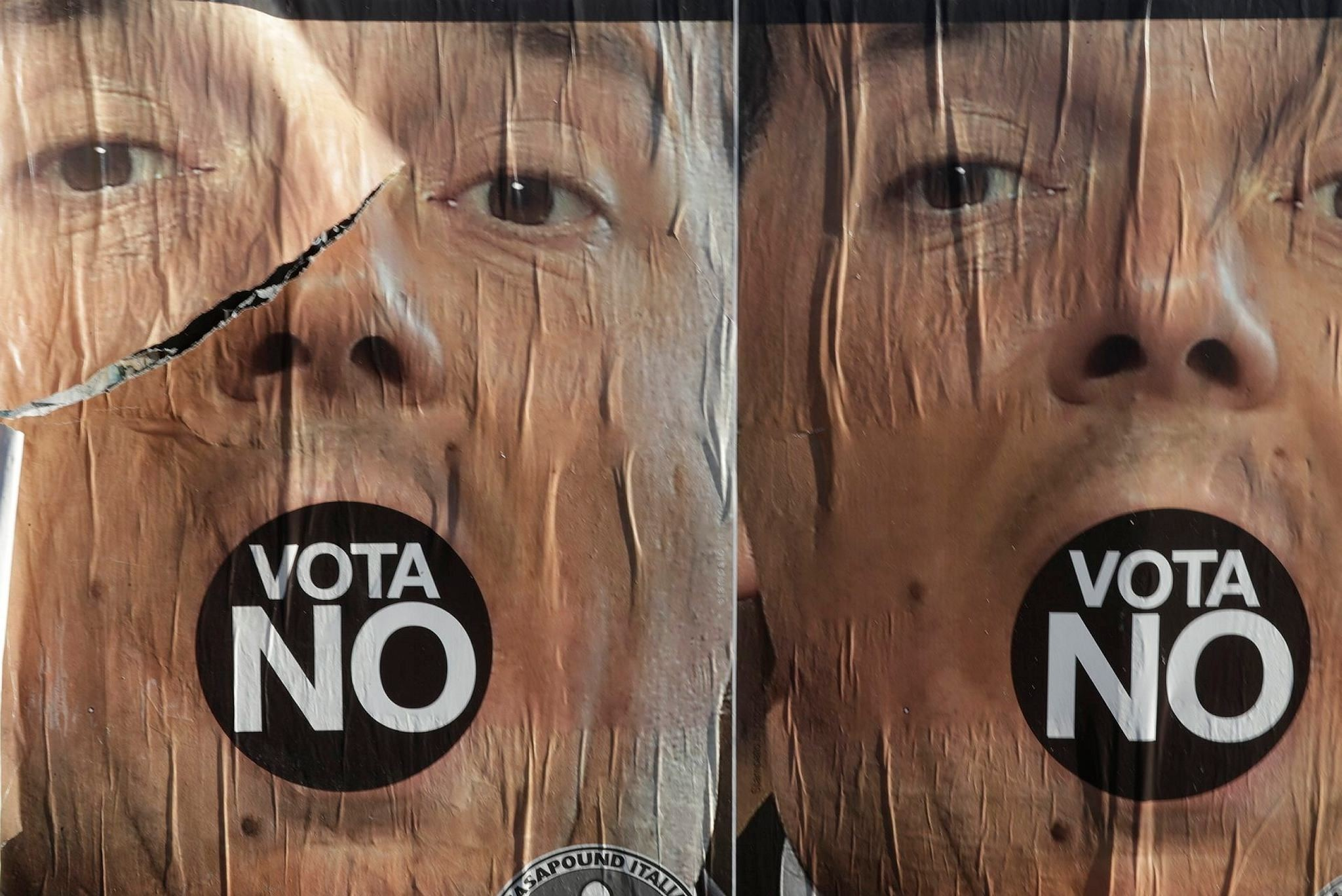 Anti-referendum posters showing Premier Matteo Renzi are seen in Rome a day after the referendum vote, Monday, Dec. 5, 2016. (AP Photo)
