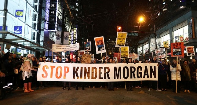 Protesters walk down Robson Street in opposition to Canada's decision to approve Kinder Morgan Inc's pipeline from the Alberta oil sands to the Pacific coast in Vancouver, B.C. (Reuters Photo)