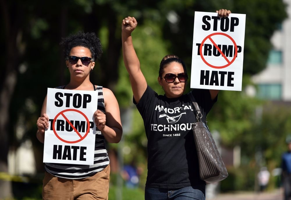 Two women arriving at a protest near where Republican presidential candidate Donald Trump will speak at a rally in Fresno, California on May 27, 2016.