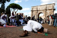 Several hundred Muslims staged a protest prayer outside the Colosseum in Rome on Friday over what they see as unfair restrictions on their freedom to practice their faith in Italy.