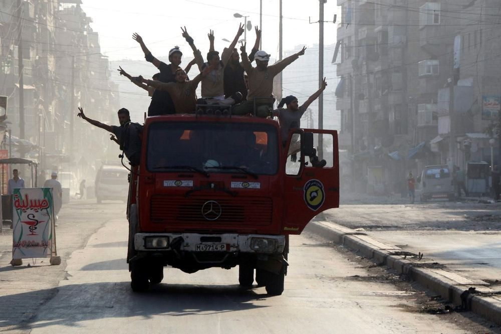 Syrians celebrate the opposition groups' major military advance in Aleppo.