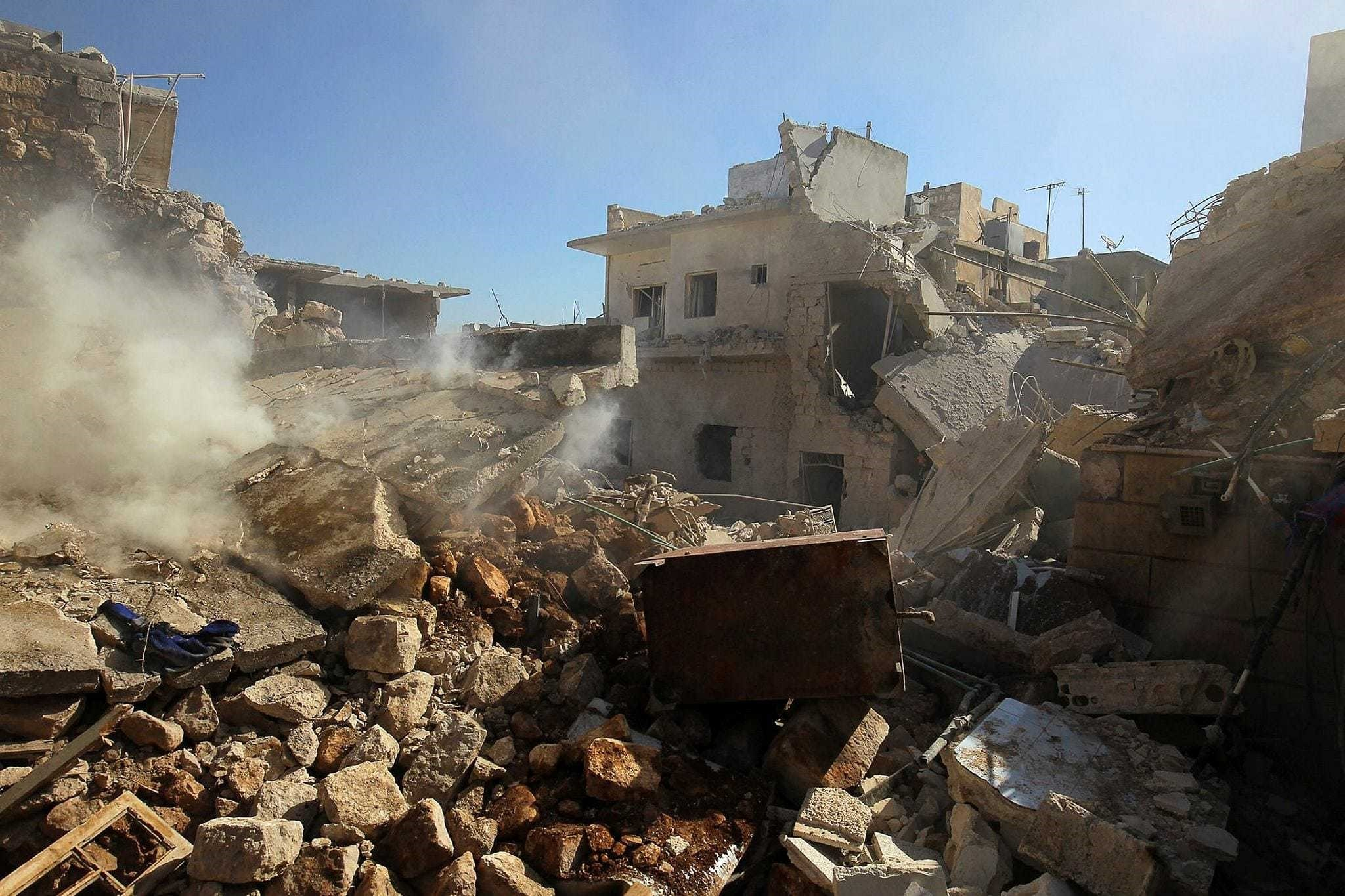 Smoke rises from damaged buildings after an airstrike on the opposition-held town of Darat Izza, province of Aleppo, Syria, Nov. 5.