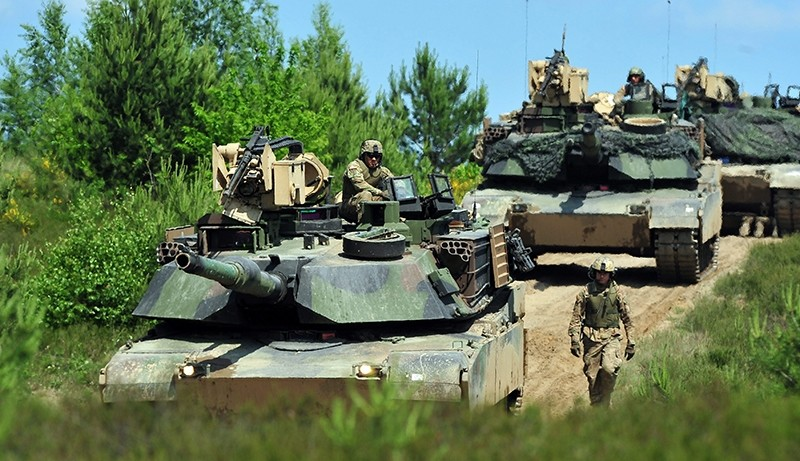 Tanks drive past during the Polish-led multinational exercise Anakonda 2016 at the training ground Drawsko Pomorskie, north-western Poland, 04 June 2016 (EPA Photo)