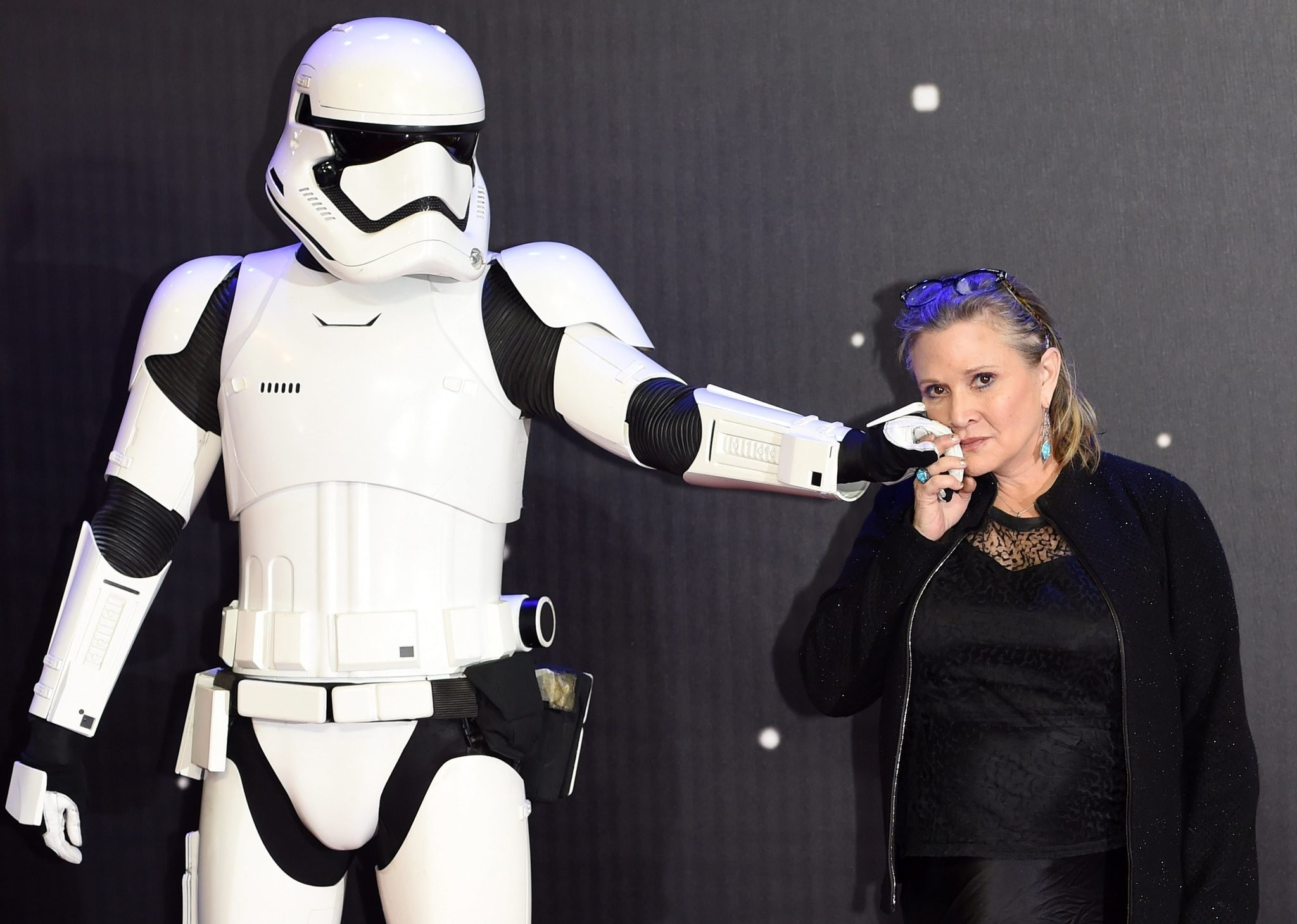 A  file picture dated 16 Dec 2015 shows cast member Carrie Fisher posing next to a Stormtrooper film character at the European premiere of 'Star Wars'. (EPA Photo)