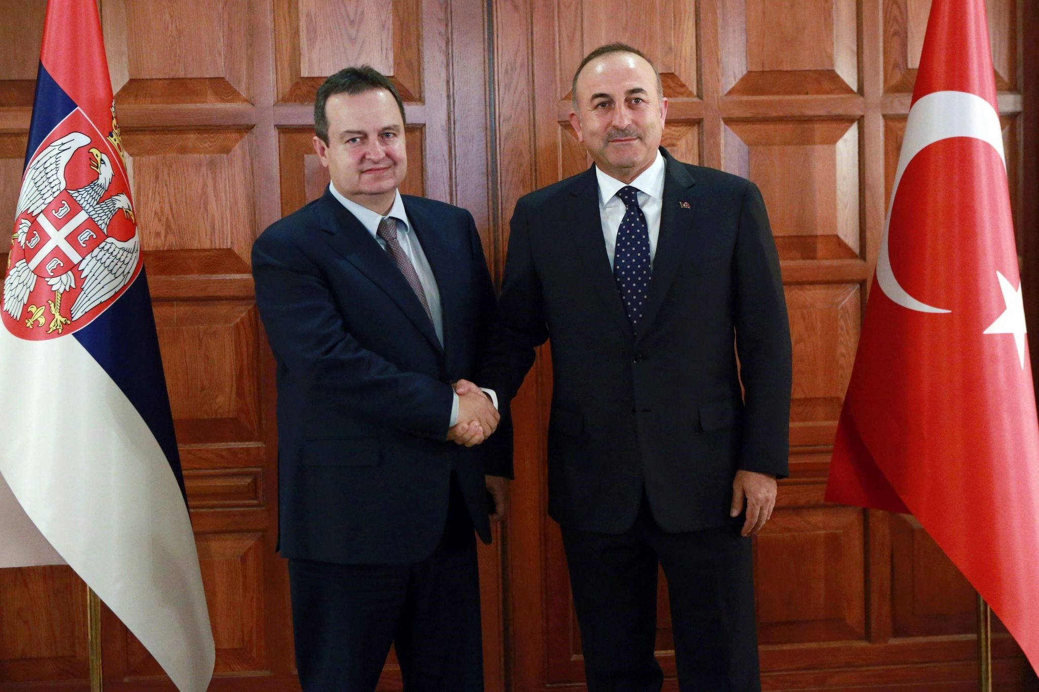 Foreign Minister u00c7avuu015fou011flu (R) shakes hands with Serbian counterpart Dacic in Ankara, October 5, 2016. (AFP Photo)