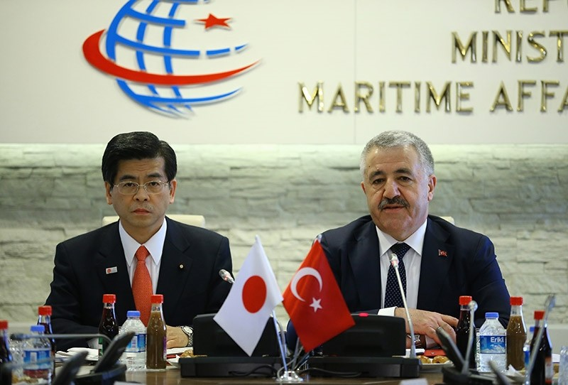 Turkish Minister of transport, maritime affairs and communication Ahmet Arslan (R) with his Japanese counterpart. Jan. 18, 2017. (AA Photo)
