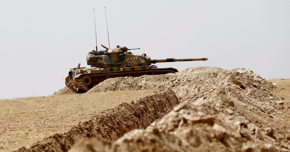 Turkish soldiers waiting their tanks as they prepare for a military operation on the Syrian border as part of their offensive against DAESH in Syria, the Karkamu0131u015f district of Turkey's southeastern Gaziantep province, Aug. 27.