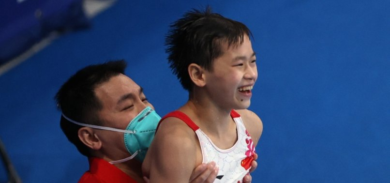 14-YEAR-OLD CHINESE ATHLETE WINS OLYMPIC GOLD IN DIVING