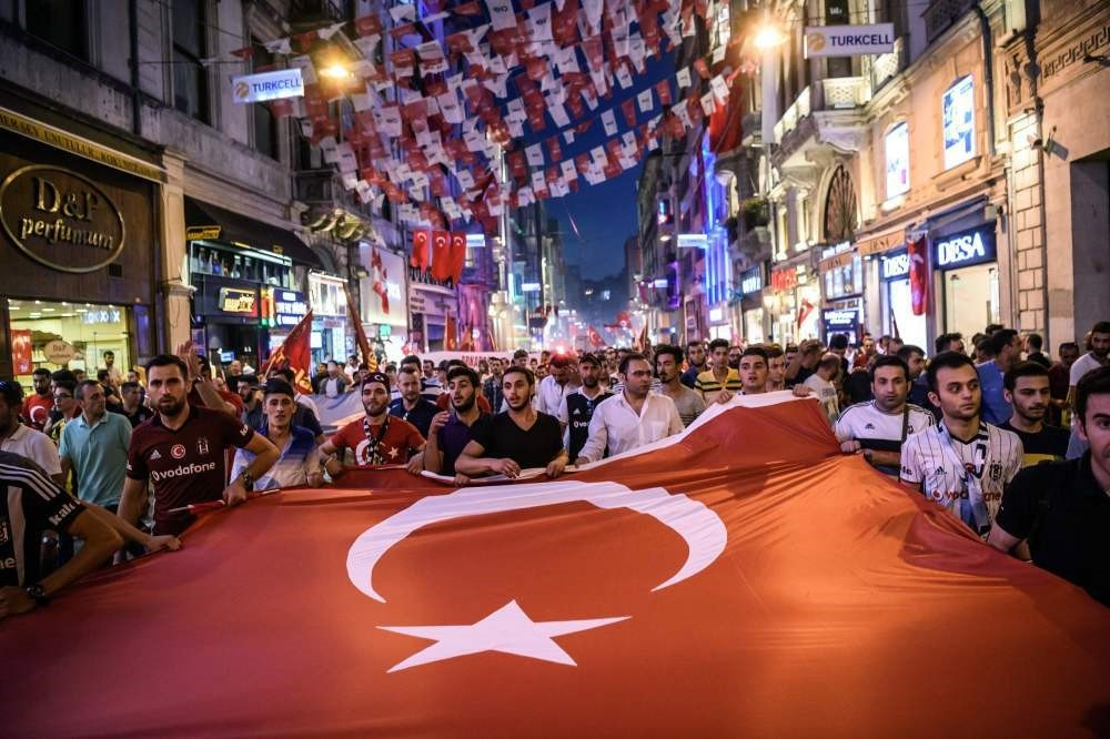 Turkish football supporters taking part in a rally against the failed coup attempt in Taksim Square, Istanbul on July 23.