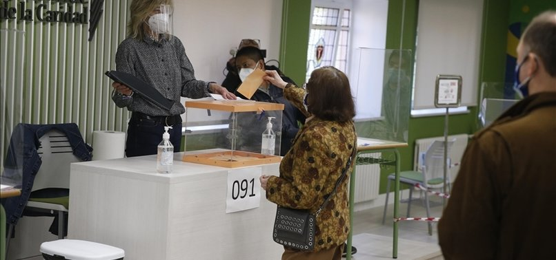 MADRID VOTERS GO TO POLLS AFTER BITTER CAMPAIGN