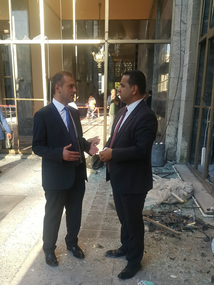 Kandemir (L) spoke to Ali u00dcnal from Daily Sabah in one of the demolished parts of the Parliament due to airstrike in the coup attempt on Friday.