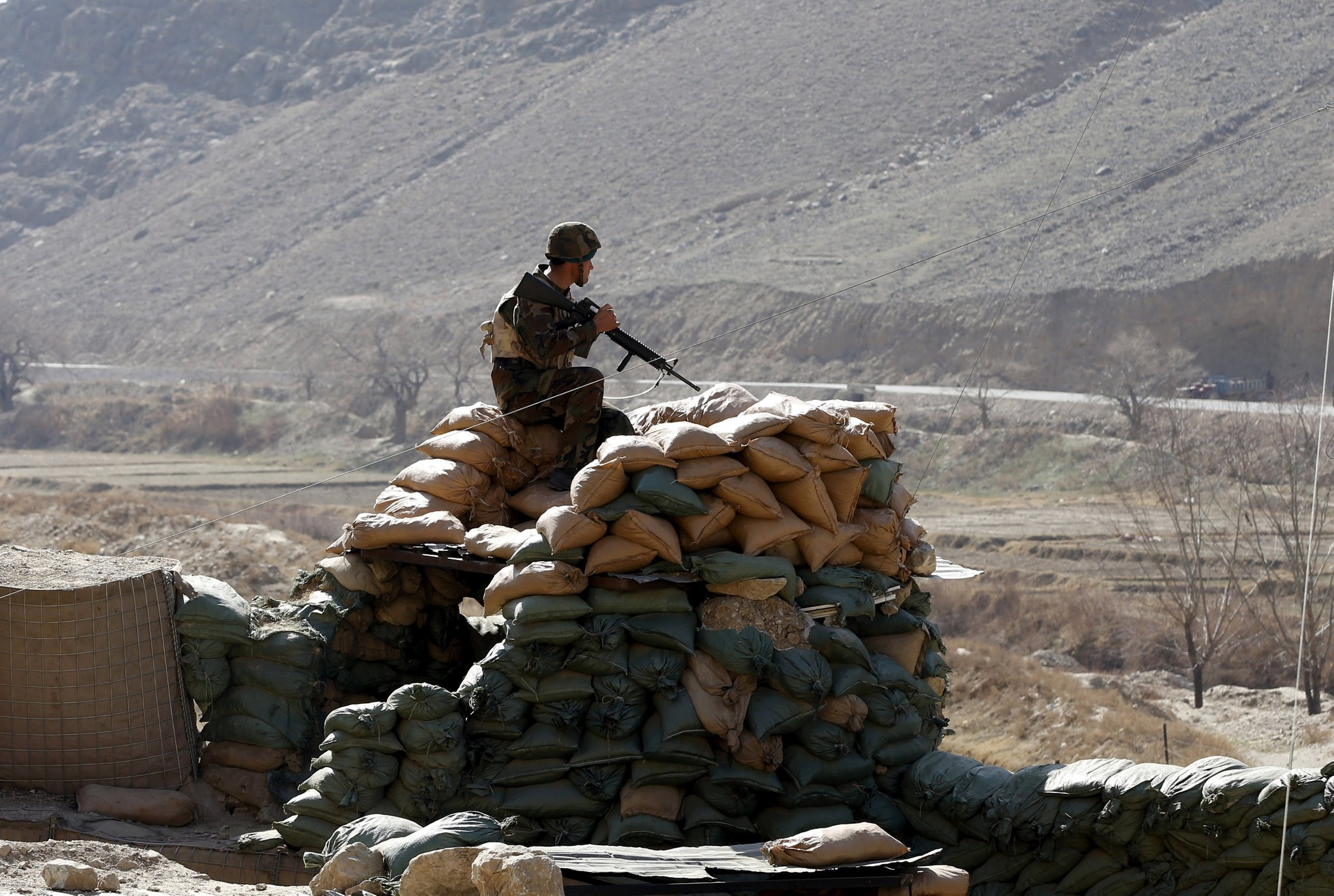 An Afghan National Army (ANA) soldier keeps watch at a checkpost in Logar province, Afghanistan, Feb. 16, 2016. (REUTERS Photo)