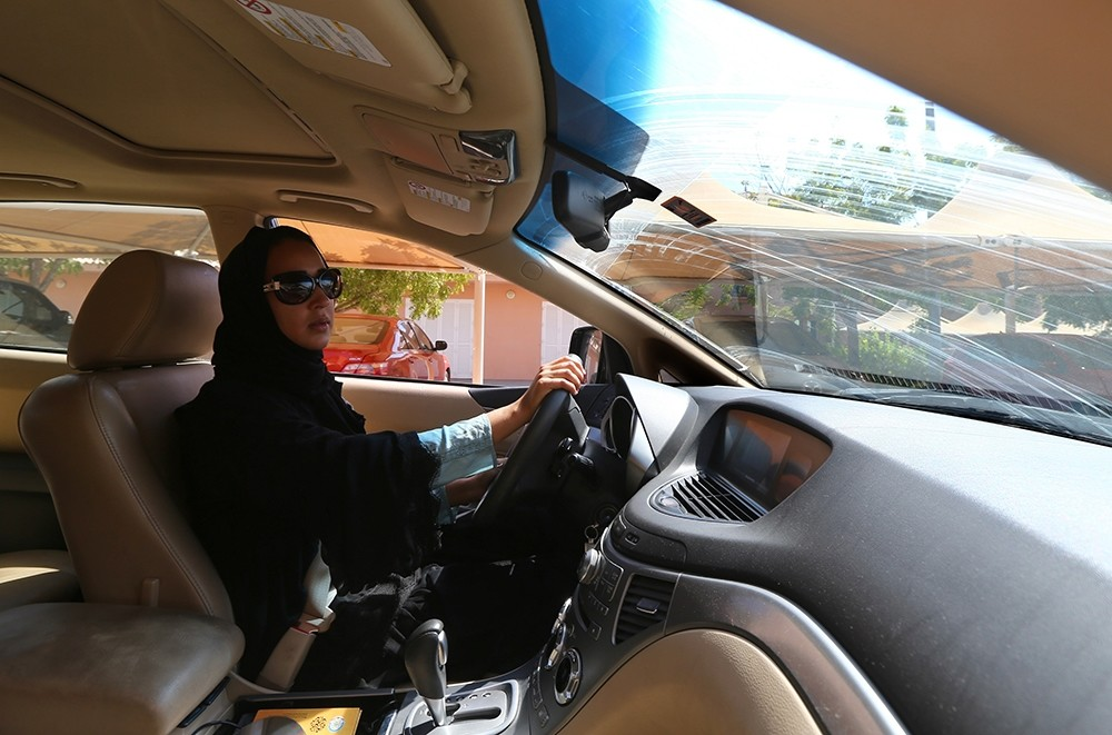 Saudi activist Manal al-Sharif, who helped spark the 2011 driving protest, behind the wheel in Dubai. (AFP Photo)