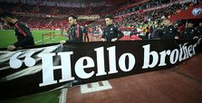 Turkish footballers hold 'Hello Brother' banners