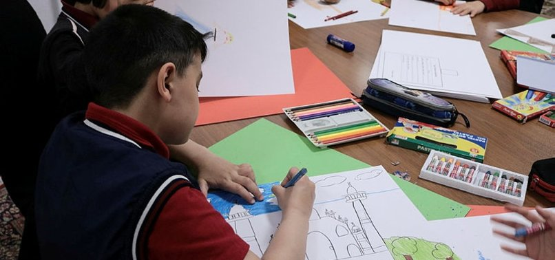 TURKISH CHILDREN DEPICT INDIA WITH PAINTBRUSH