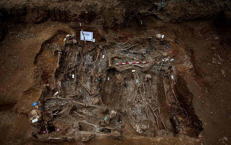 The remains of bodies are seen during the exhumation of the one of the three mass graves that contain in total the remains of around 200 bodies believed to have been killed by Spain's late dictator (Reuters Photo)