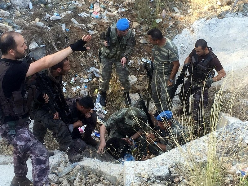 Security forces check a culvert where fugitive pro-coup soldiers were hiding in Marmaris, western Turkey, July 25. (AA Photo)