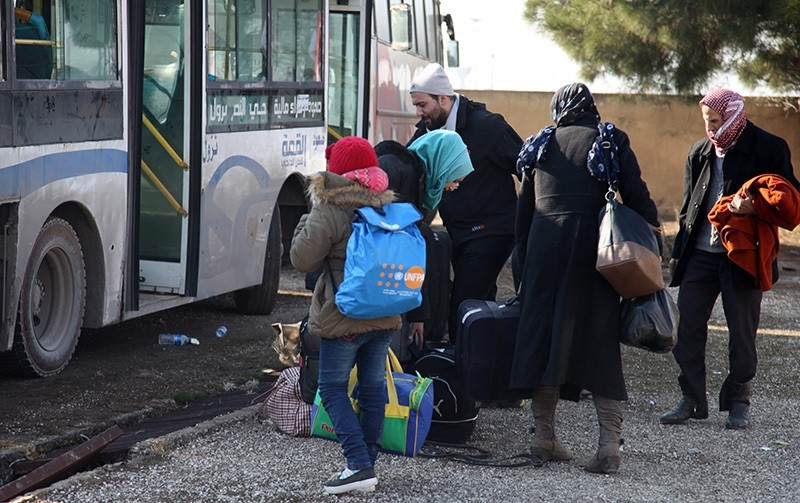 Syrians who were evacuated from Kafarya and Fuah villages of Idlib province arrive at a temporary housing center in Jebrin, Aleppo countryside, Syria (EPA Photo)