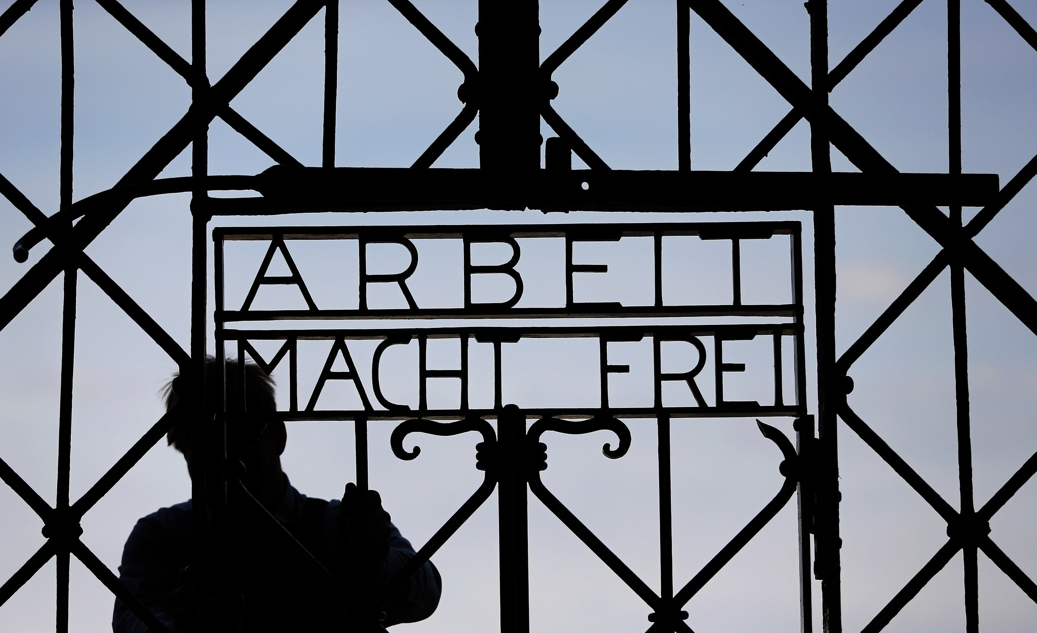 In this April 29, 2015 file picture a blacksmith prepares a replica of the Dachau Nazi concentration camp gate, with the writing ,Arbeit macht frei, (Work Sets you Free) (AP Photo)