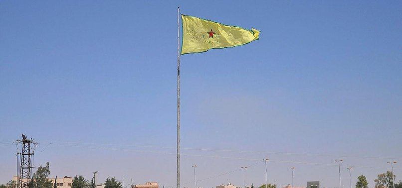 YPG/PKK REPLACES FLAG WITH NEW ONE IN SYRIA'S TAL ABYAD