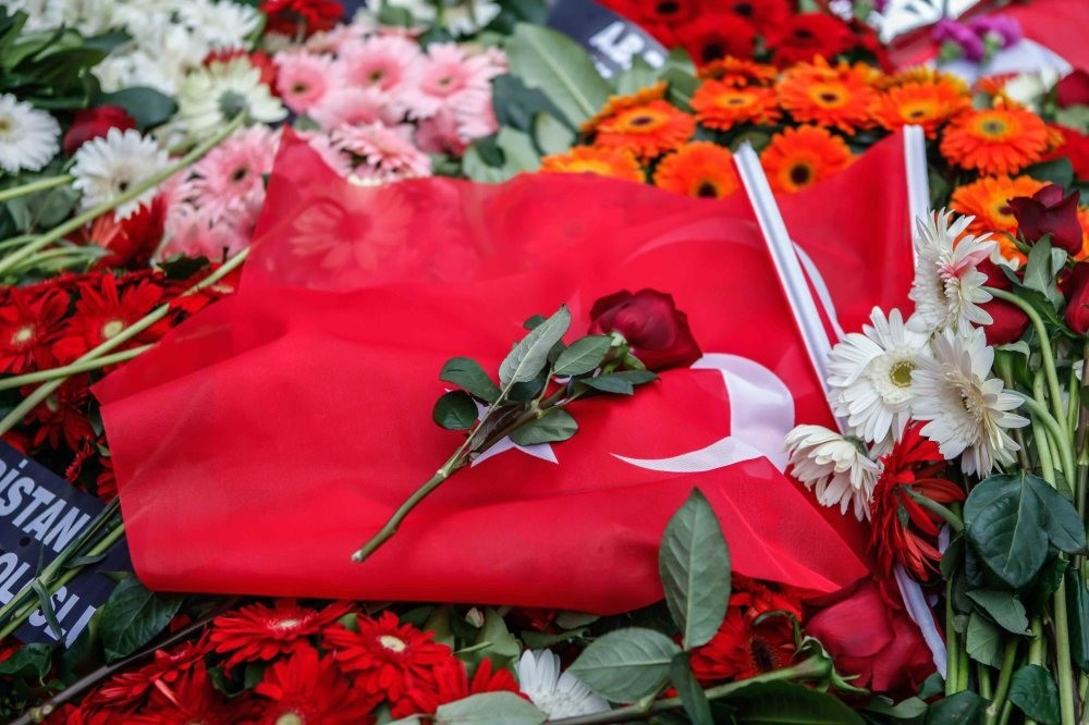 Locals paid tribute to the victims of the recent terror attack in Beu015fiktau015f by leaving flowers and Turkish flags at the scene.
