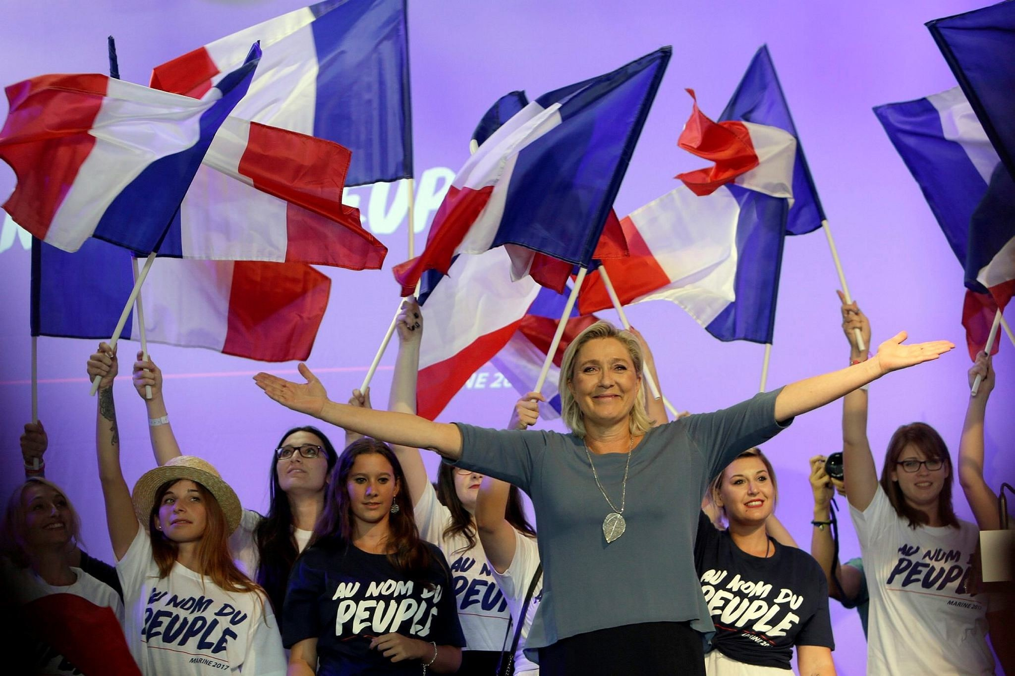 France's far-right National Front president Marine Le Pen waves to supporters during a summer meeting in Frejus, southern France.