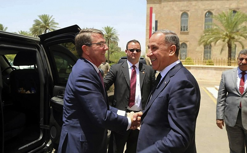 Visiting U.S. Defense Secretary Ash Carter, left, shakes hands with Iraqi Defense Minister Khaled al-Obeidi at the Ministry of Defense, Baghdad, Iraq, Monday, July 11, 2016 (AP Photo)