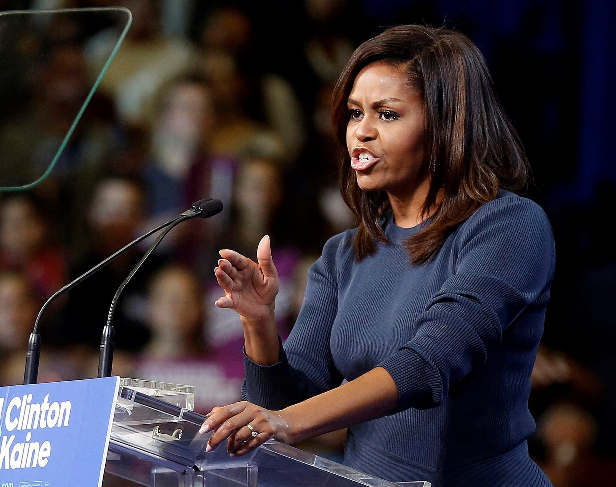 First lady Michelle Obama speaks during a campaign rally for Democratic presidential candidate Hillary Clinton Thursday, Oct. 13, 2016, in Manchester, N.H. (AP Photo)