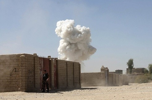 Smoke rises after a suicide attack, killing 10 police officers by Taliban militant in Lashkar Gah the capital of southern Helmand province of Afghanistan, Oct. 10, 2016. (AP Photo)
