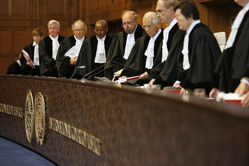 Judges, with presiding judge Ronny Abraham of France, fifth from left, enter the World Court in The Hague, Netherlands, Wednesday, Oct. 5, 2016. (AP Photo)