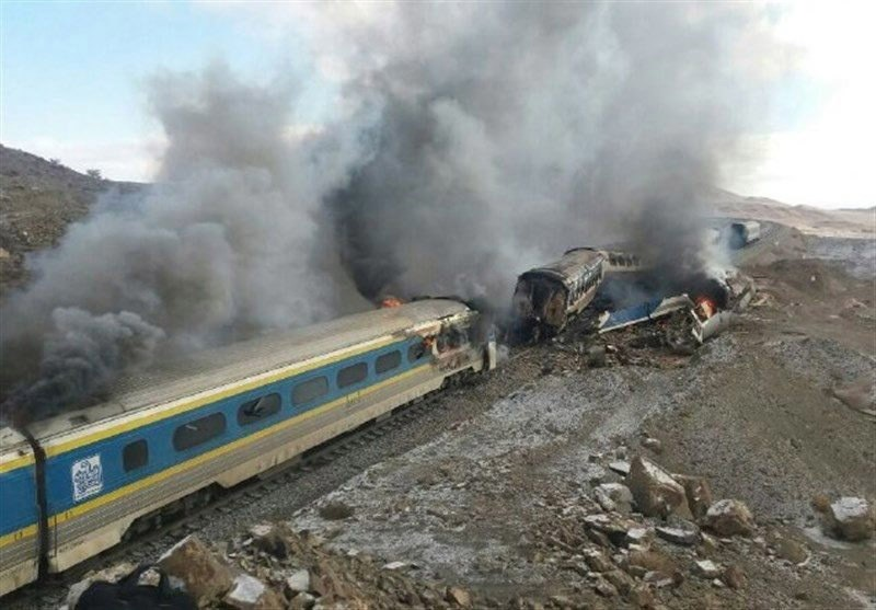 Smoke billows from destroyed train coaches at the site of a train accident in the city of Semnan, central Iran on Nov. 25, 2016.  (EPA Photo)